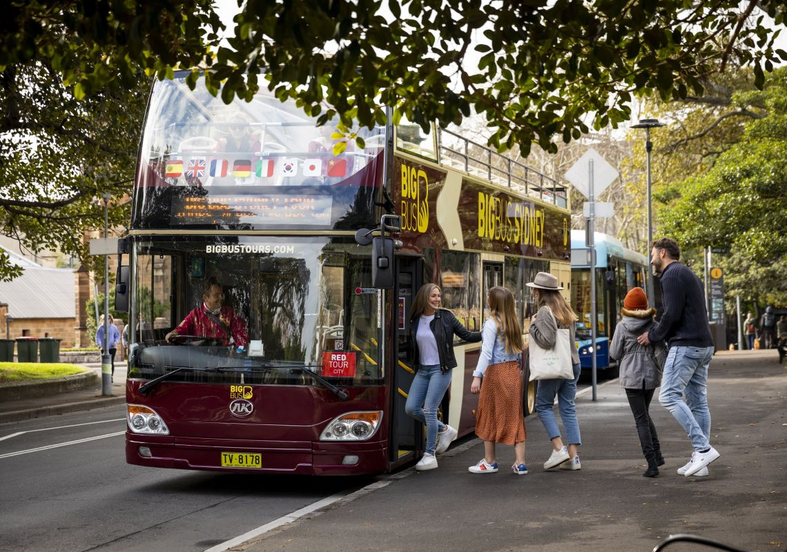 Family boarding the Big Red Bus Tours near The Rocks, Sydney