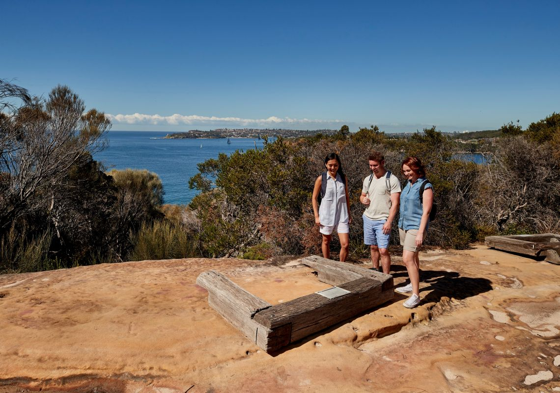 Friends visiting the Grotto Point Aboriginal engravings along the Spit Bridge to Manly walk