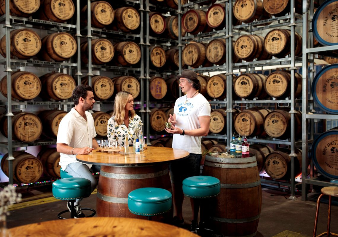 Couple enjoying a gin distillery tour and tasting experience at Manly Spirits Co. Distillery, Brookvale.