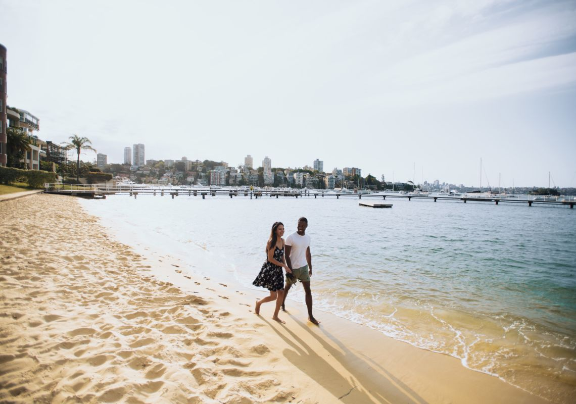 Couple enjoying a walk by Murray Rose Pool in Double Bay, Sydney East