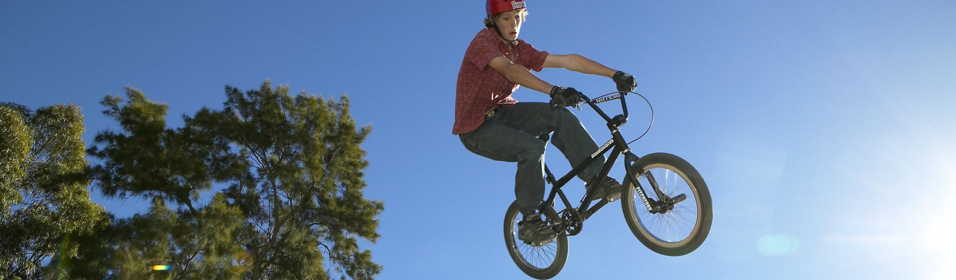 Teenager performing a BMX stunt at Jamison Park in Penrith