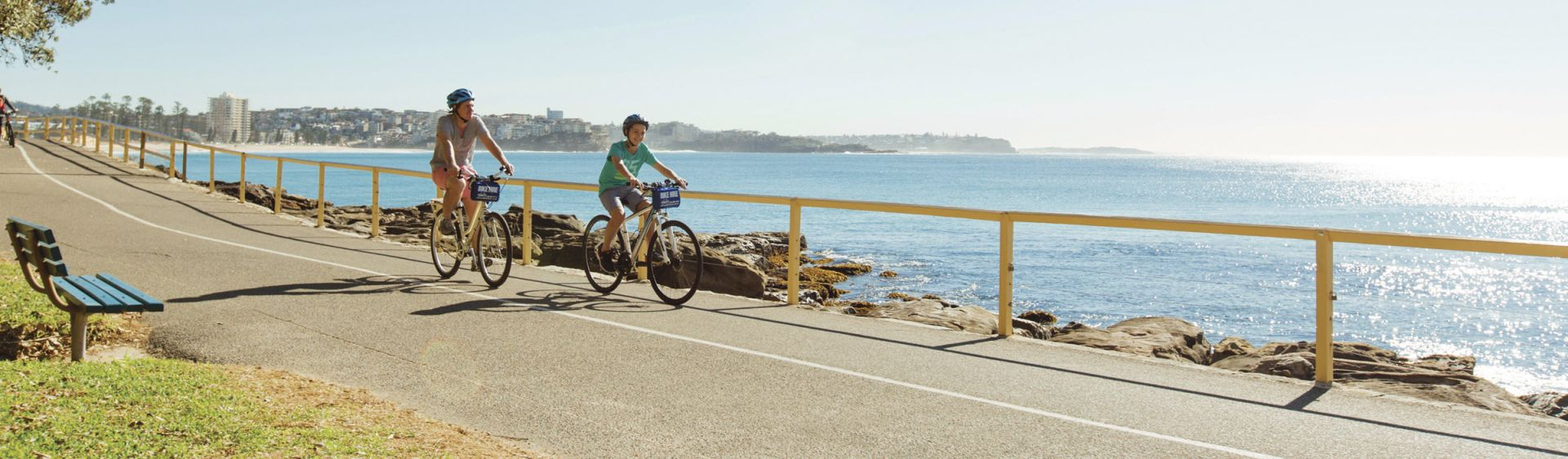 Father and son enjoying a bike ride in Manly, Sydney