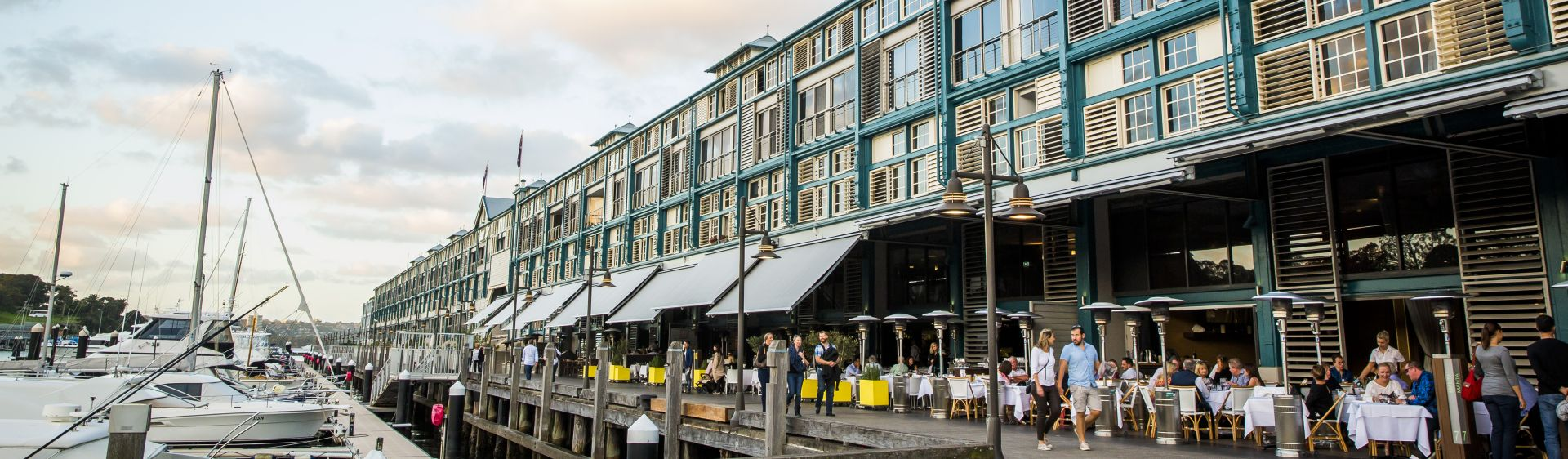 People enjoying the restaurant-lined Finger Wharf in Woolloomooloo, Sydney