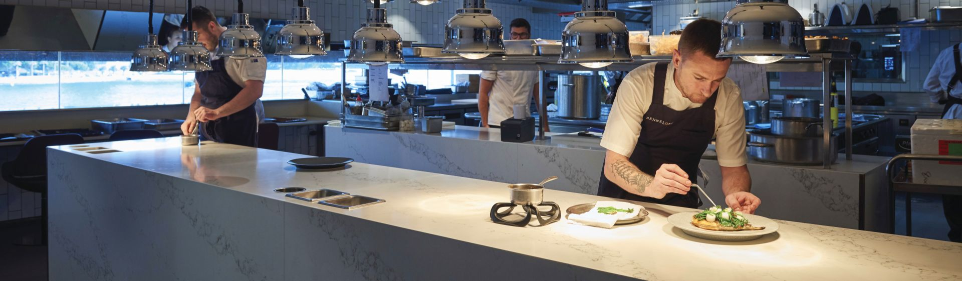 Chefs preparing food at Bennelong Restaurant, in the Sydney Opera House