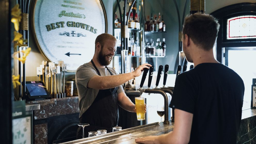 Bartender pouring a beer at the Endeavour Tap Rooms, The Rocks