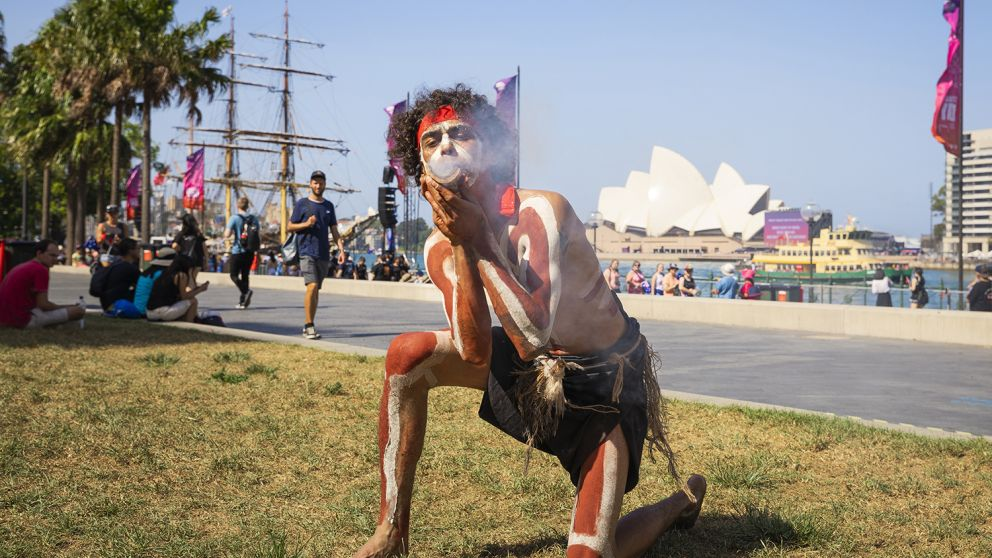 Man performing a smoking ceremony on Australia Day in Sydney Harbour, Sydney City