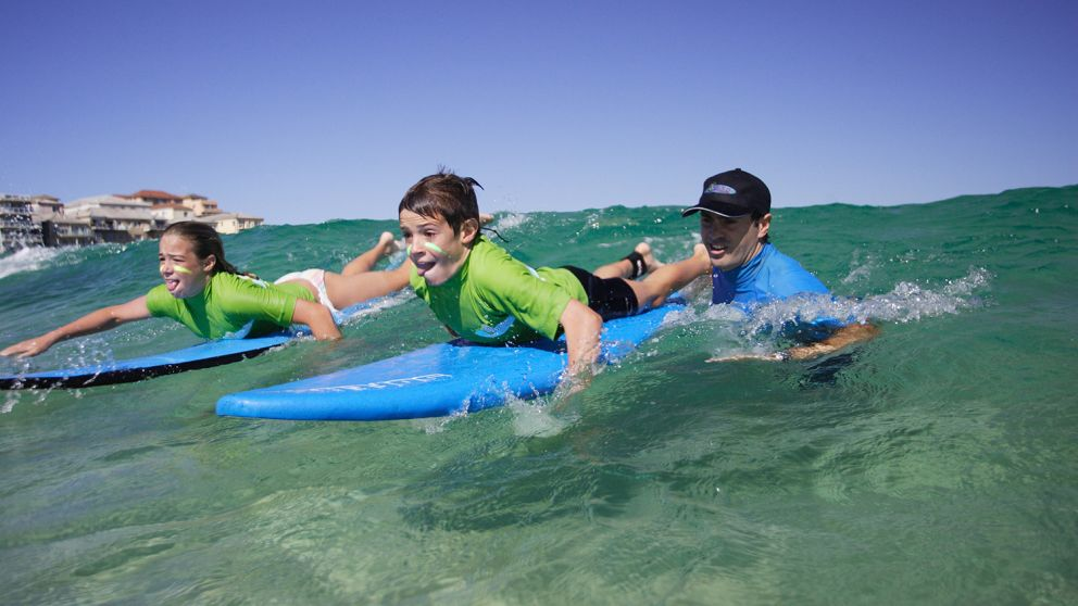 Children learning to surf with 'Let's Go Surfing' at Bondi