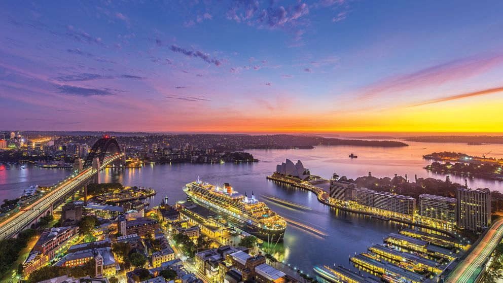 Aerial over Circular Quay and Sydney Icons at Sunrise
