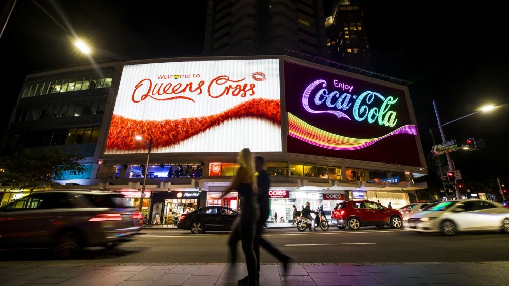 The Coca-Cola sign also known as 'The Coke Sign' lit up for the Mardi Gras weekend in Kings Cross, Sydney