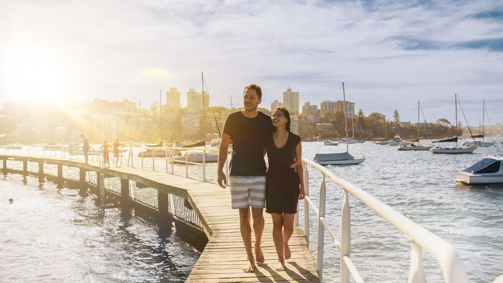 Couple relaxing by Murray Rose Pool in Double Bay, Sydney East