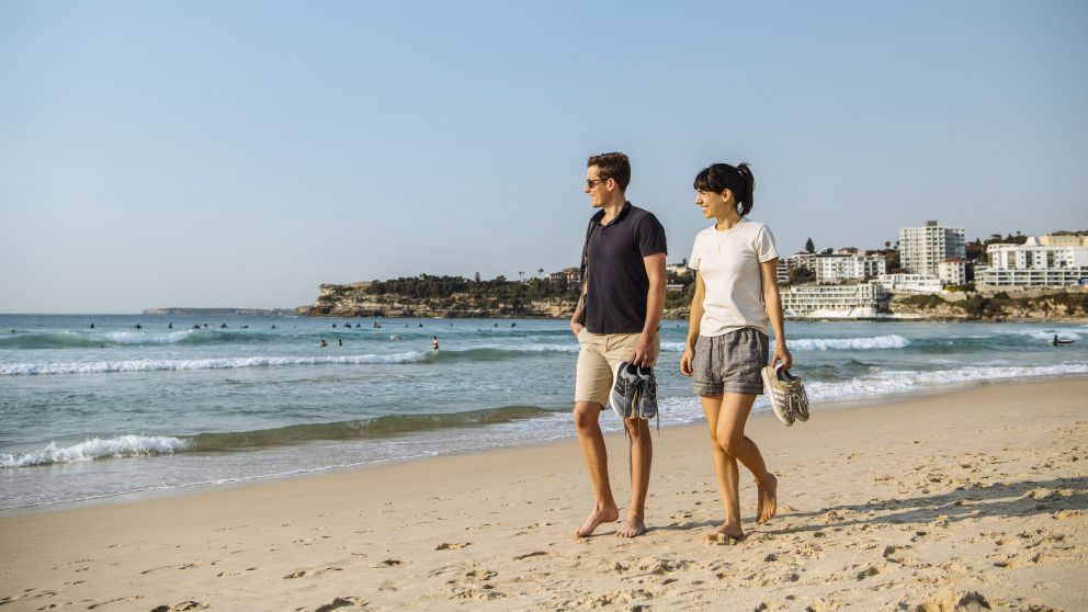 Couple enjoying a walk along Bondi Beach in Bondi, Sydney