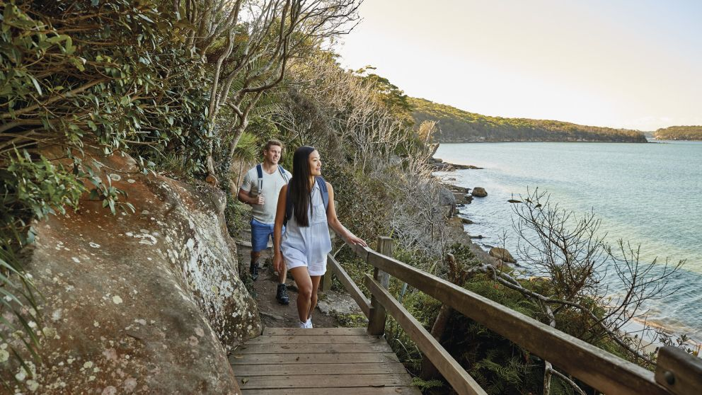 Couple enjoying the walk from Spit Bridge to Manly with scenic views across Sydney Harbour, Sydney