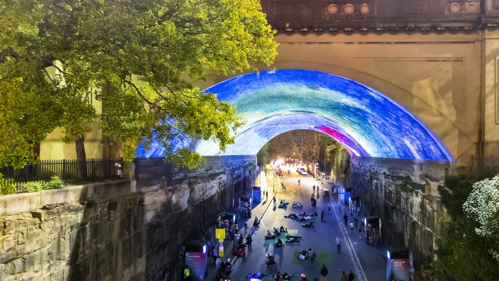 Crowds enjoying the Pixar: 30 Years of Animation light projection on the Argyle Cut, The Rocks during Vivid Sydney