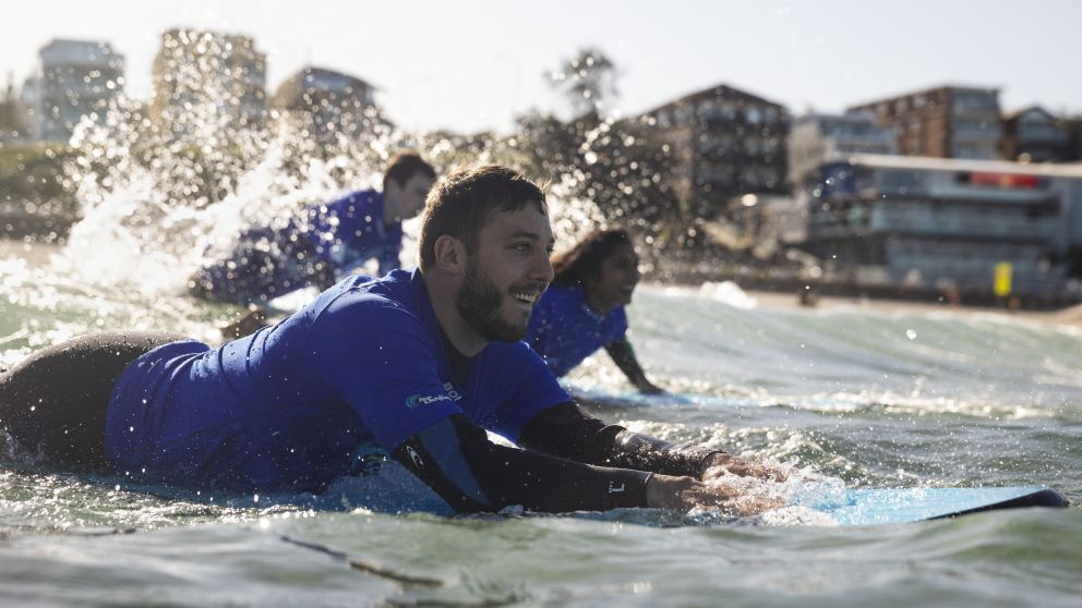 Man enjoying a surf lesson with Lets Go Surfing, Bondi Beach