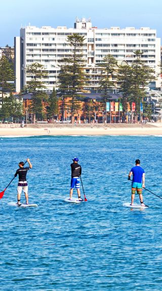 Stand up paddleboardingin Manly, Sydney North