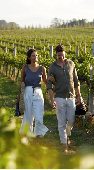 Couple enjoying a scenic walk through the vineyards at Rowlee Wines, Nashdale
