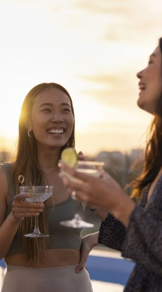 Friends enjoying drinks at sunset at The William Inglis Hotel, Warwick Farm in Sydney's south west