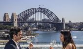 Couple enjoying food and drink with harbour views at Cafe Sydney, Sydney