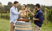Couple enjoying Swift Sparkling Wine and oysters with scenic views across Printhie Wines vineyard in Molong, near Orange