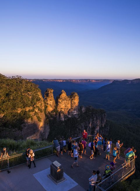 Tourists enjoying sunset views of The Three Sisters, Katoomba in the Blue Mountains