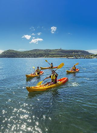 Friends kayaking on Pittwater near the Boathouse in Palm Beach