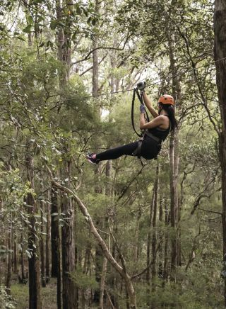 Woman enjoying a day out at the TreeTops Central Coast attraction in Wyong Creek, Central Coast
