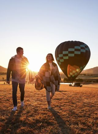 Couple arriving for a sunrise hot air balloon ride in the Hunter Valley