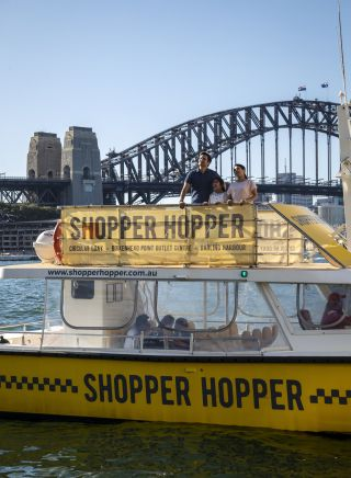 Family enjoying harbour views aboard the Shopper Hopper ferry service to Birkenhead Point Brand Outlet centre