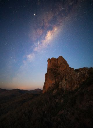 Stars lighting up the night sky over the Breadknife rock formation in Warrumbungle National Park
