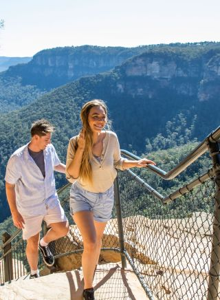 Couple enjoying a walk along the Wentworth Falls Track in the Blue Mountain National Park