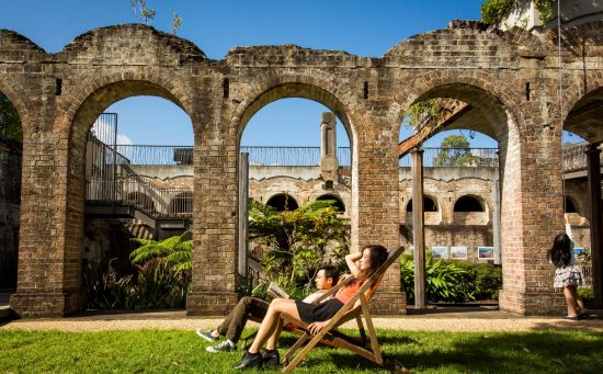 Couple relaxing in the heritage-listed Paddington Reservoir Gardens in Paddington, Sydney
