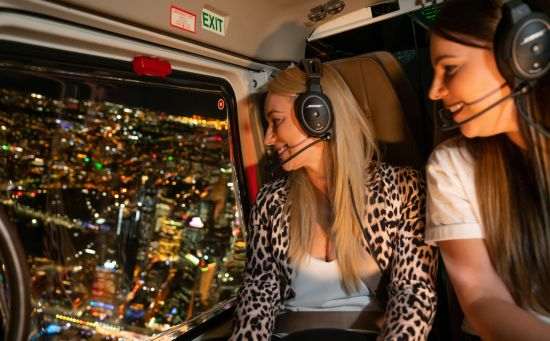 Passengers enjoying an aerial tour of Vivid Sydney 2019 with Sydney HeliTours.