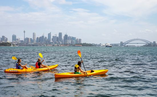 Friends enjoying a day of kayaking on Sydney Harbour