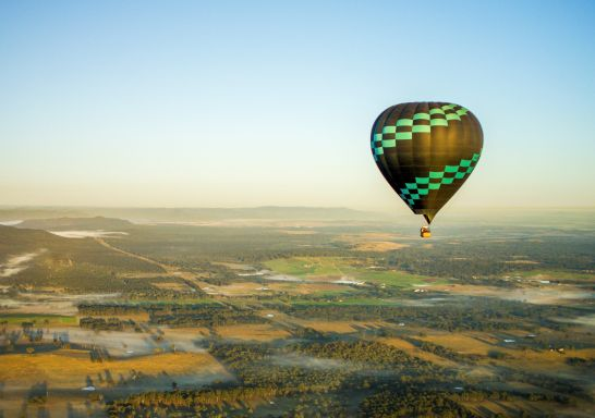 Hot air balloon flying over the Hunter Valley region, NSW Australia